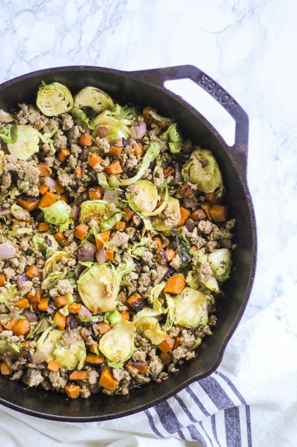 sausage breakfast skillet with Brussels sprouts and sweet  potatoes in a cast iron skillet