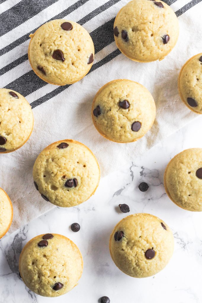 mini chocolate chip muffins with chocolate chips sprinkled around