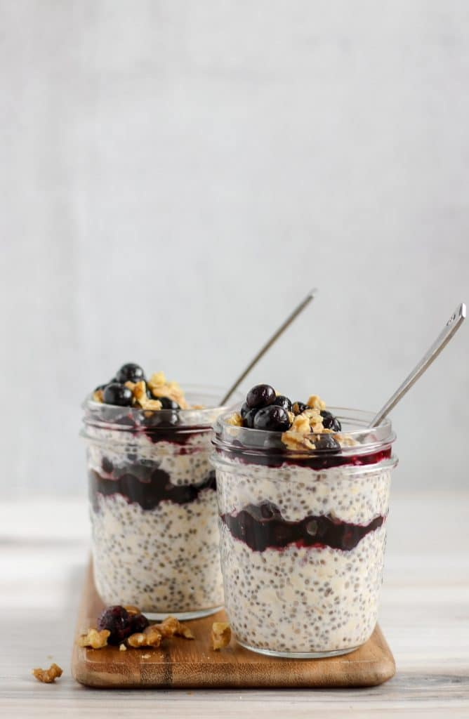 side angle view of two mason jars filled with blueberry chia overnight oats