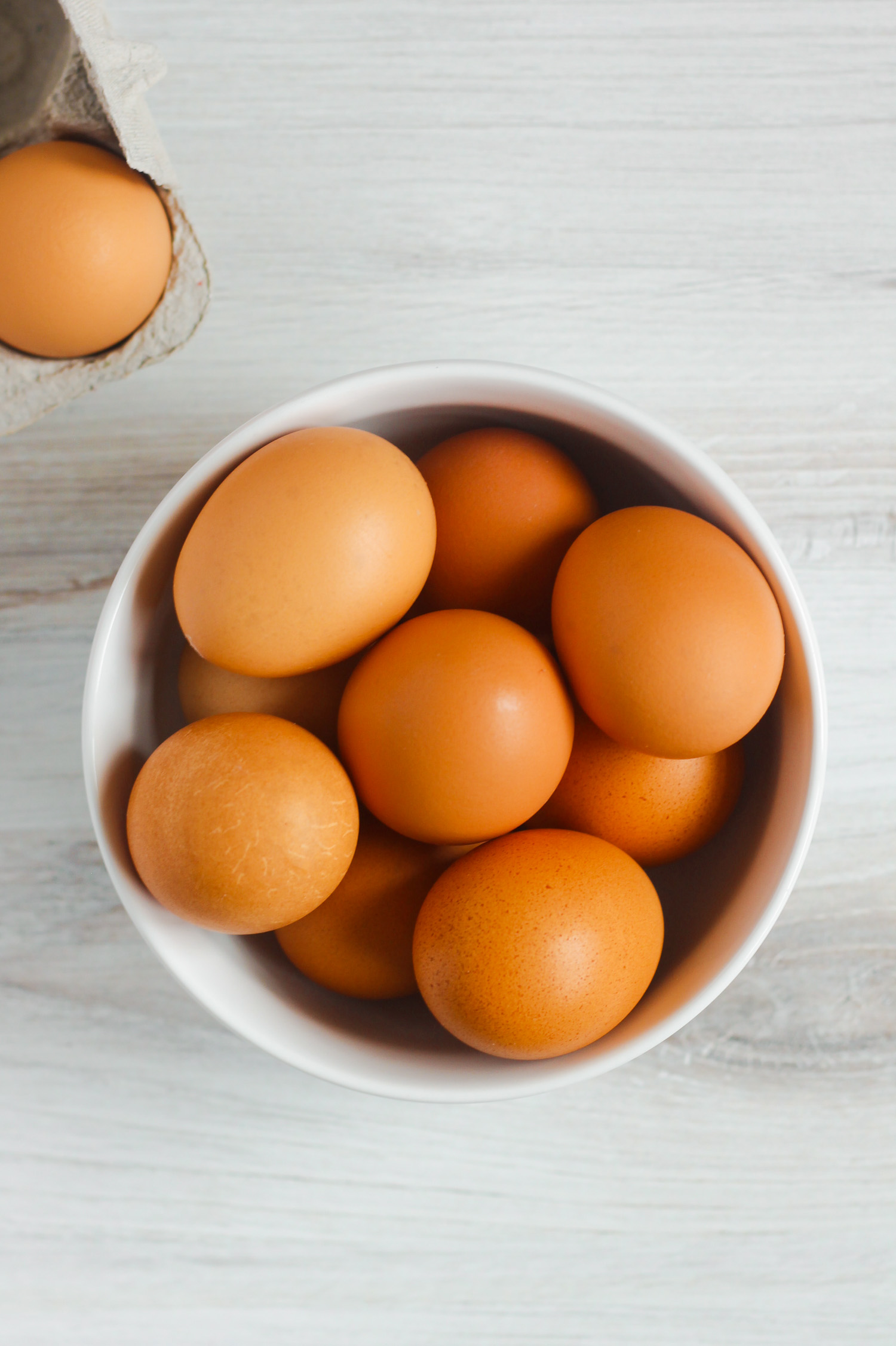 brown eggs in white bowl