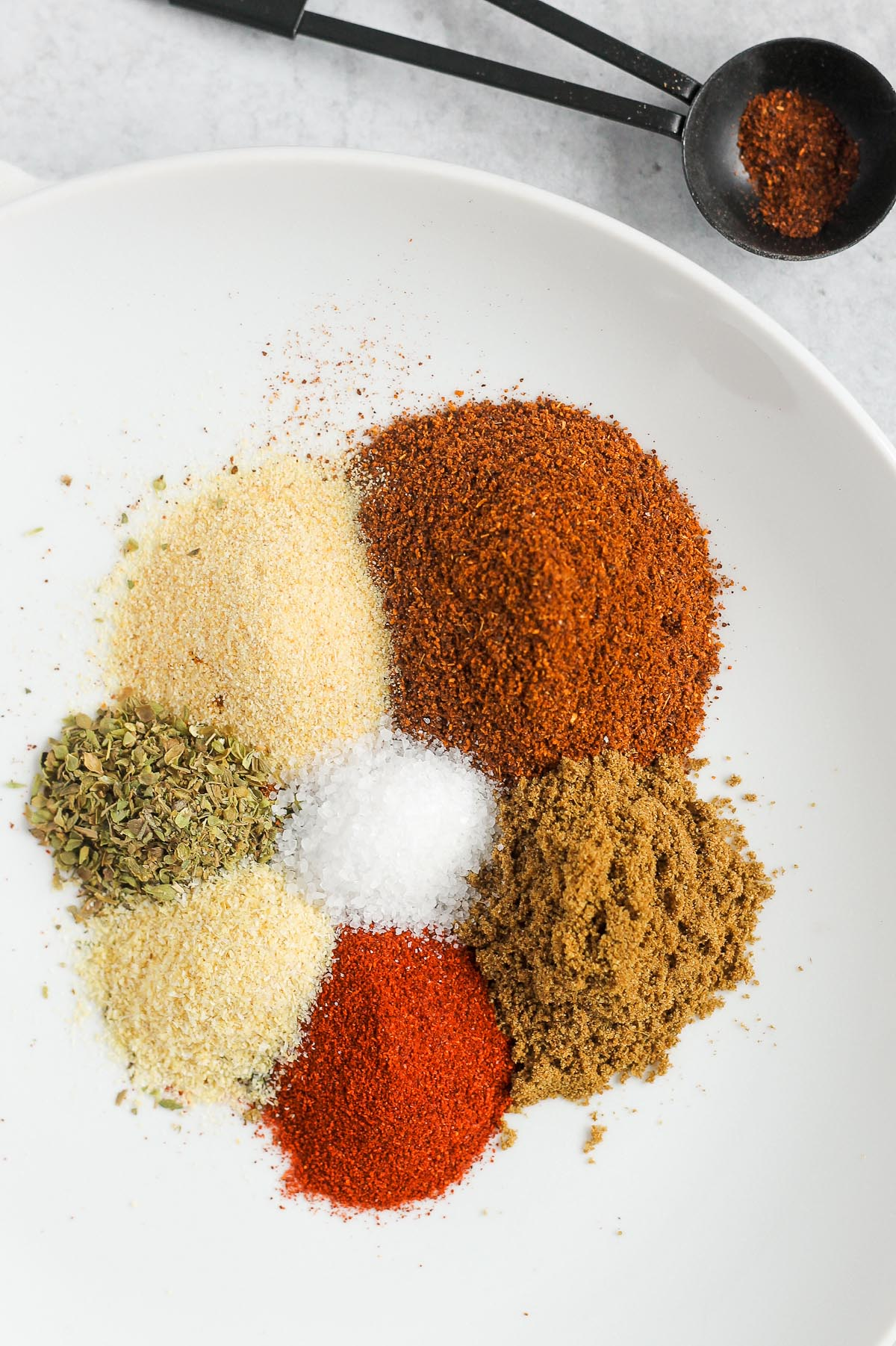 taco seasoning ingredients piled on a white plate