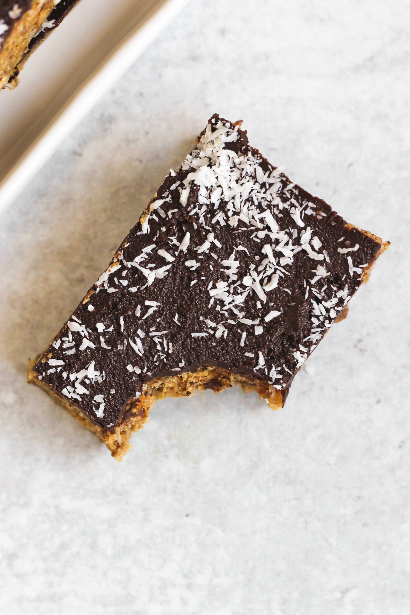 single no bake peanut butter bar with bite taken out of the corner