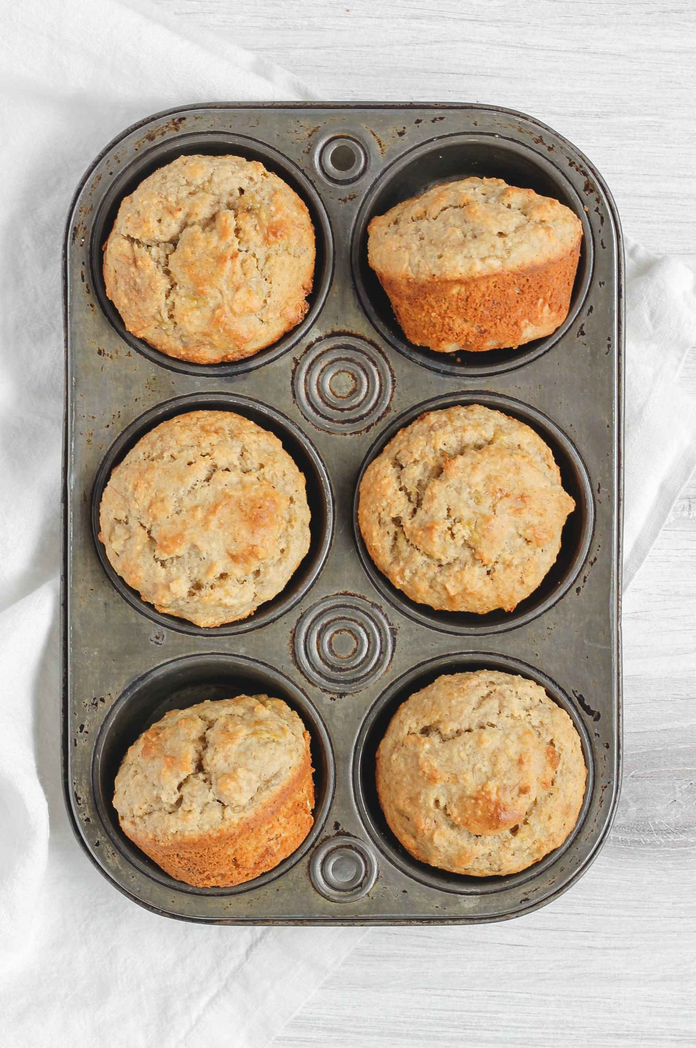 banana muffins in and antique tin muffin pan