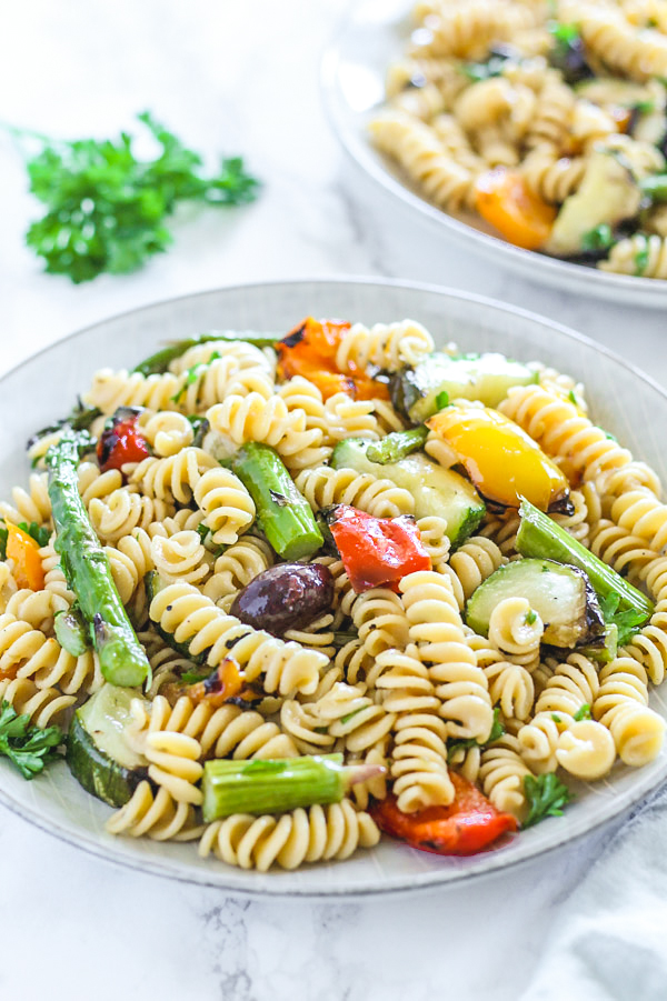 close-up view of grilled vegetable pasta salad on round plate