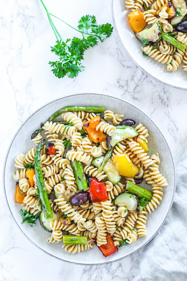 grilled vegetable pasta salad in single serve round plate