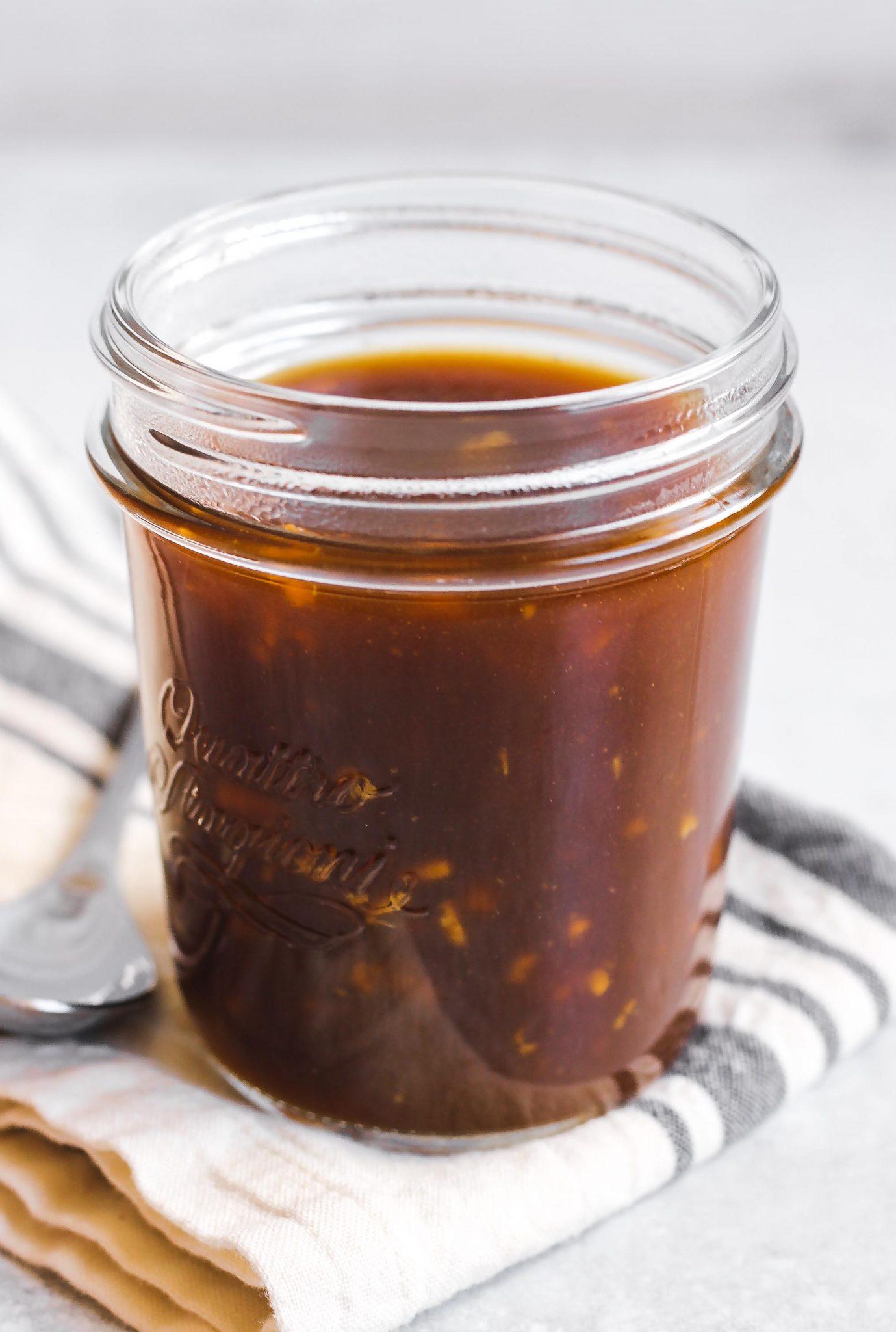 close-up view of teriyaki sauce in glass mason jar