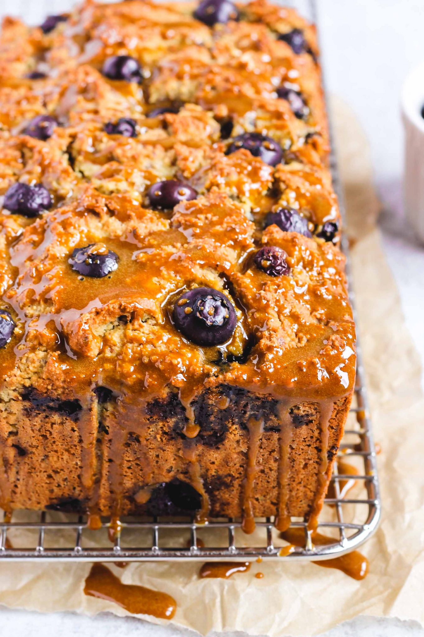 almond flour blueberry lemon loaf dripping with coconut sugar glaze