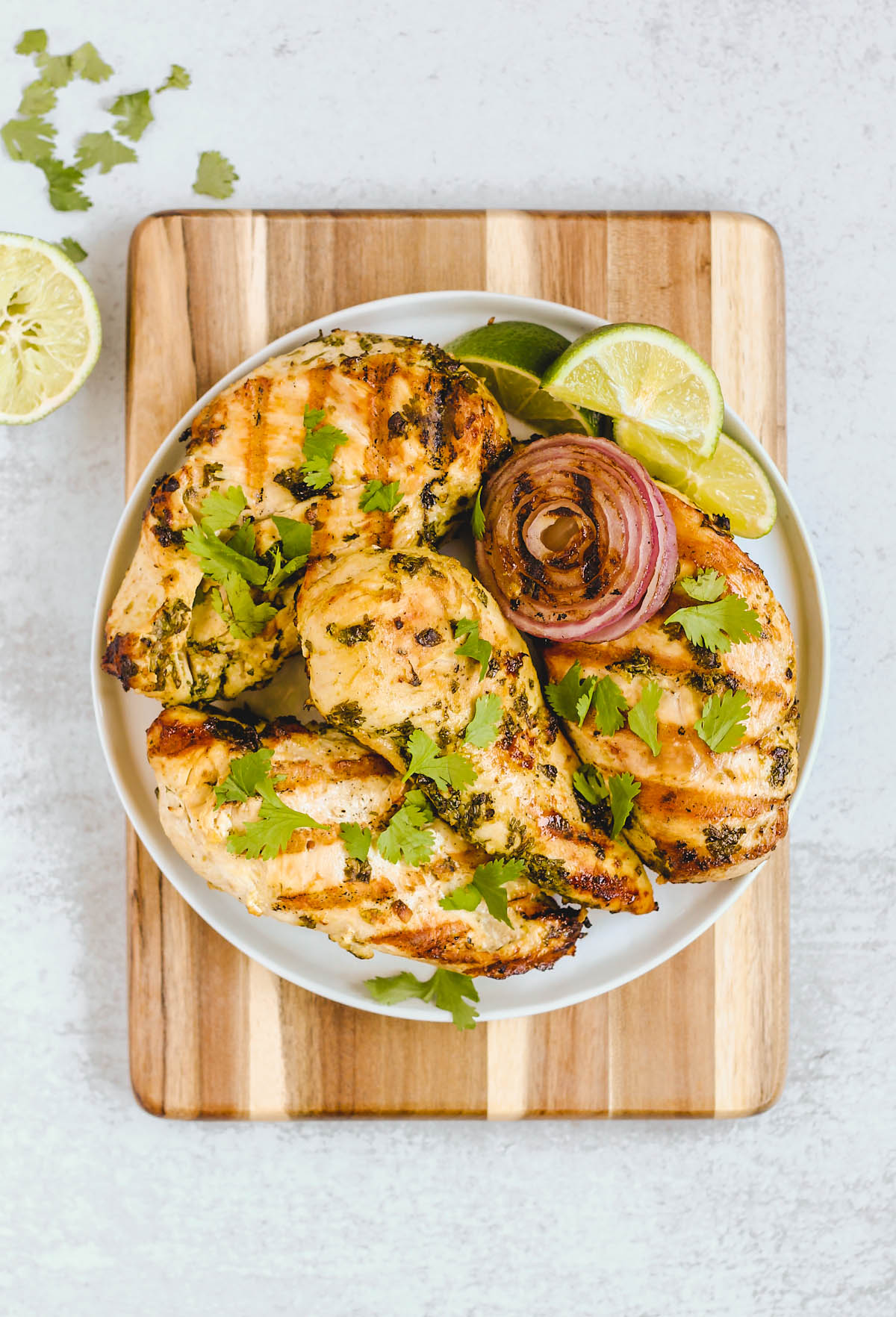 grilled cilantro chicken on white plate