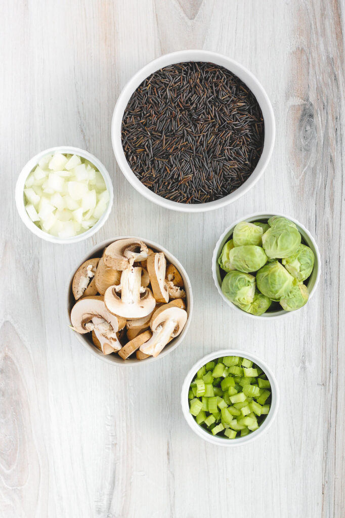overhead view of the wild rice, Brussels sprouts, onion, mushrooms and celery used in this recipe