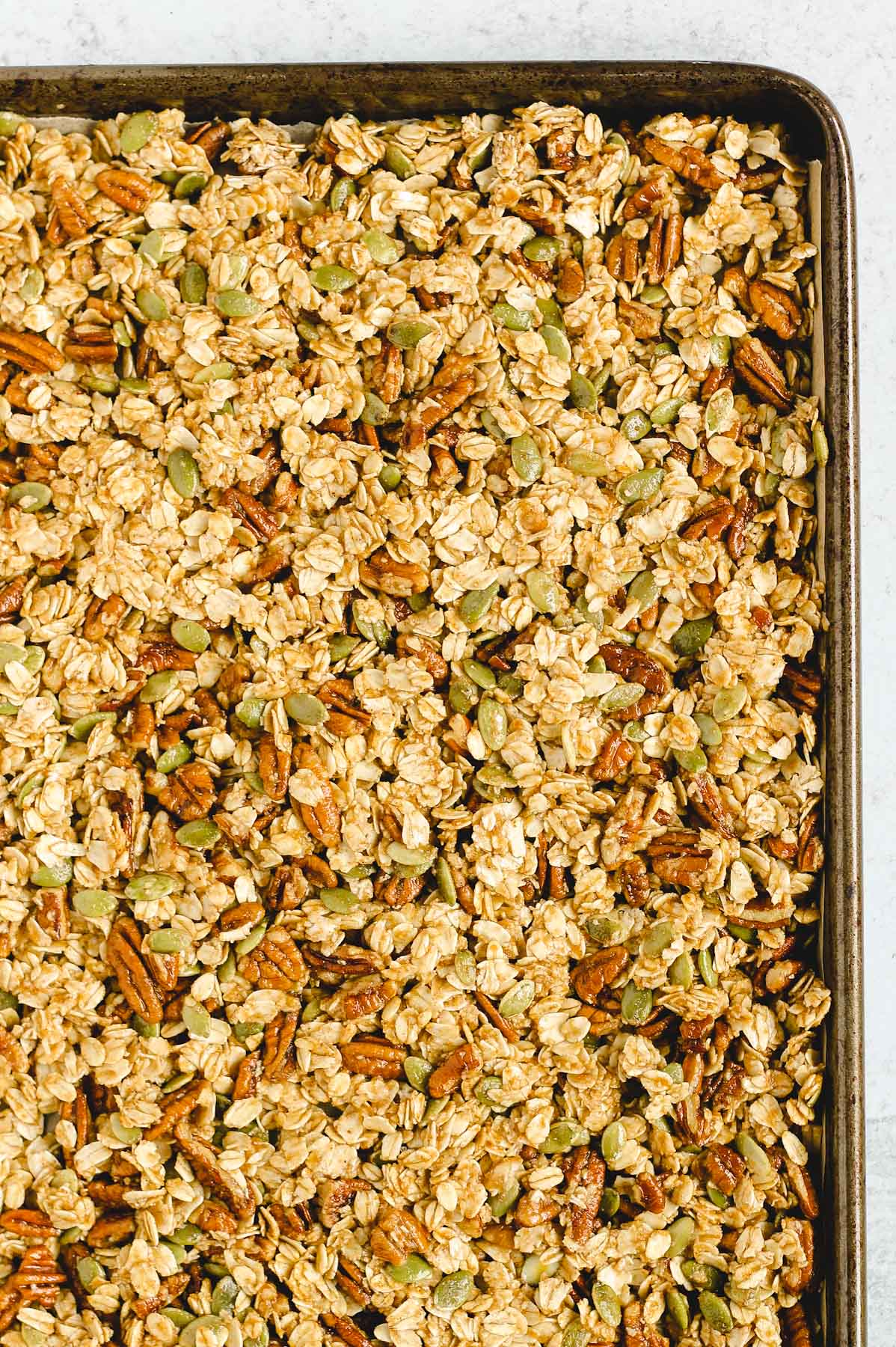 pumpkin granola on baking sheet before it has been cooked