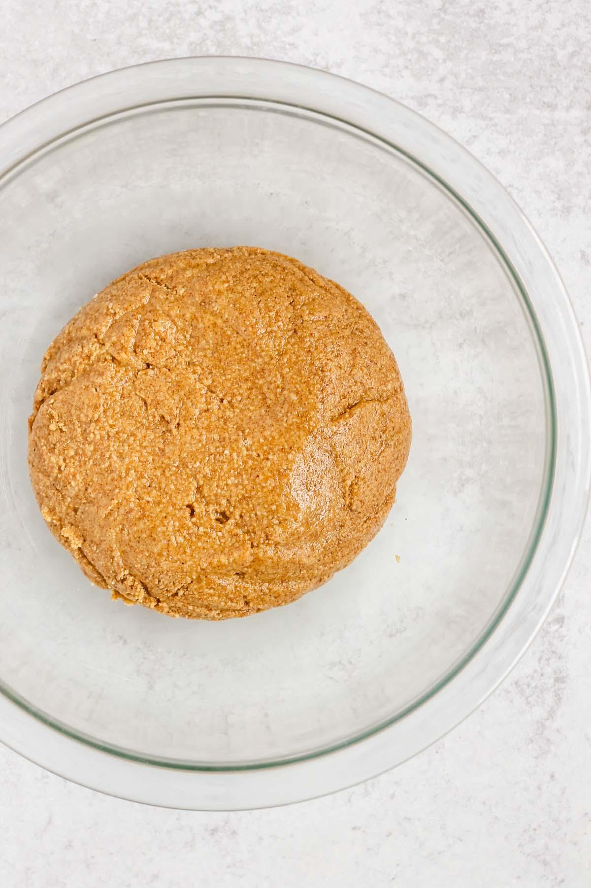 mixed peanut butter dough in a glass bowl