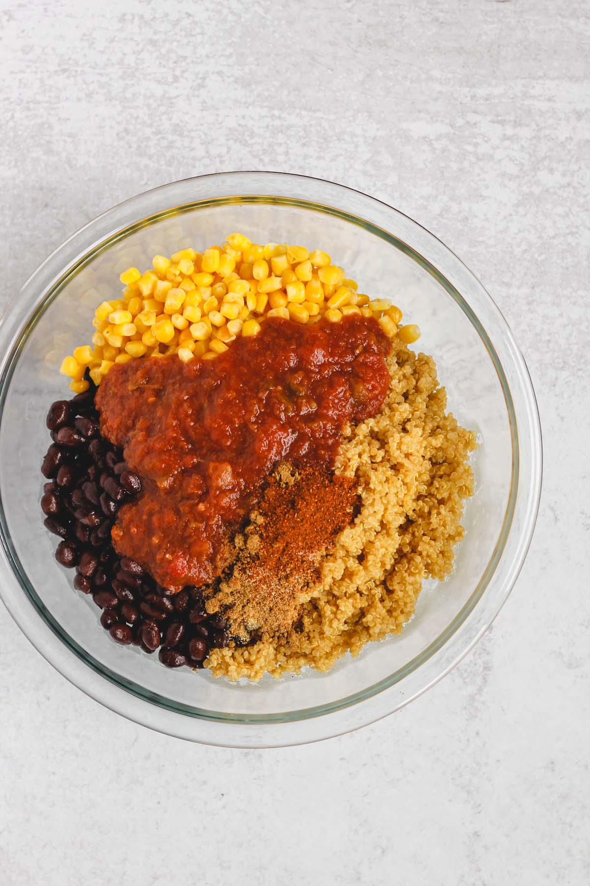 ingredients for stuffed peppers in a glass mixing bowl