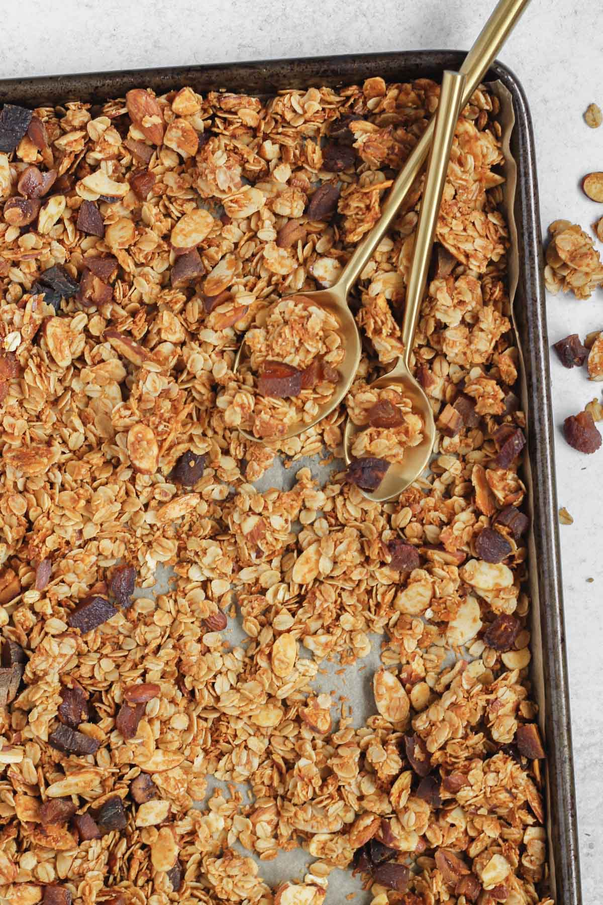 cooked granola on baking sheet
