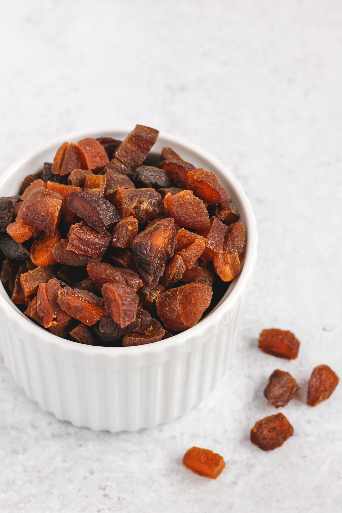 chopped dried apricots in a small white bowl