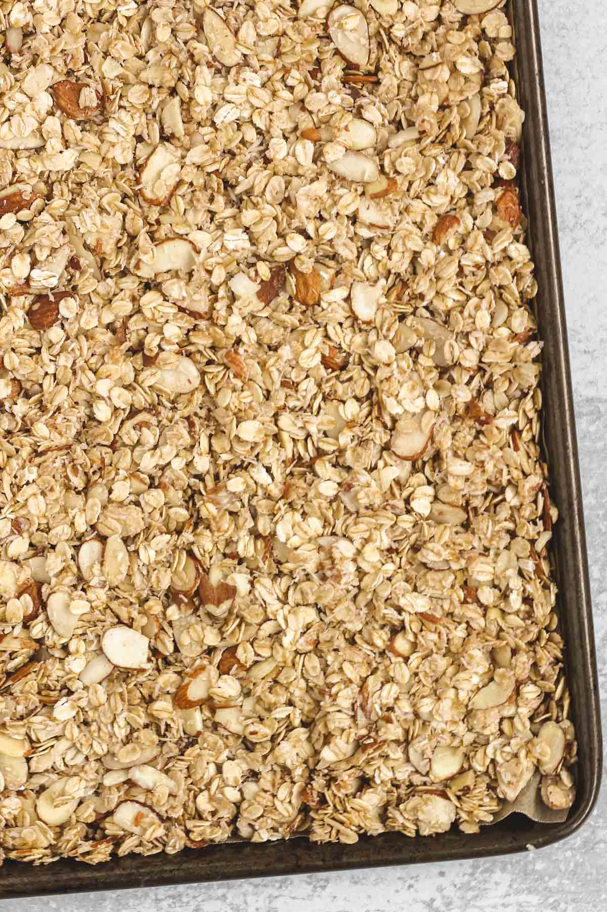 granola on baking sheet before being baked
