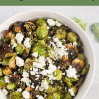 crispy Brussels sprouts drizzled with honey and sprinkled with honey with text overlay for Pinterest