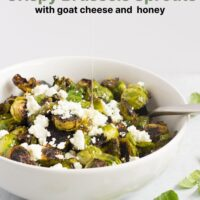 honey pouring over crispy Brussels sprouts in a white bowl with text overlay for Pinterest