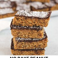stacked peanut butter oat bars with text overlay for Pinterest