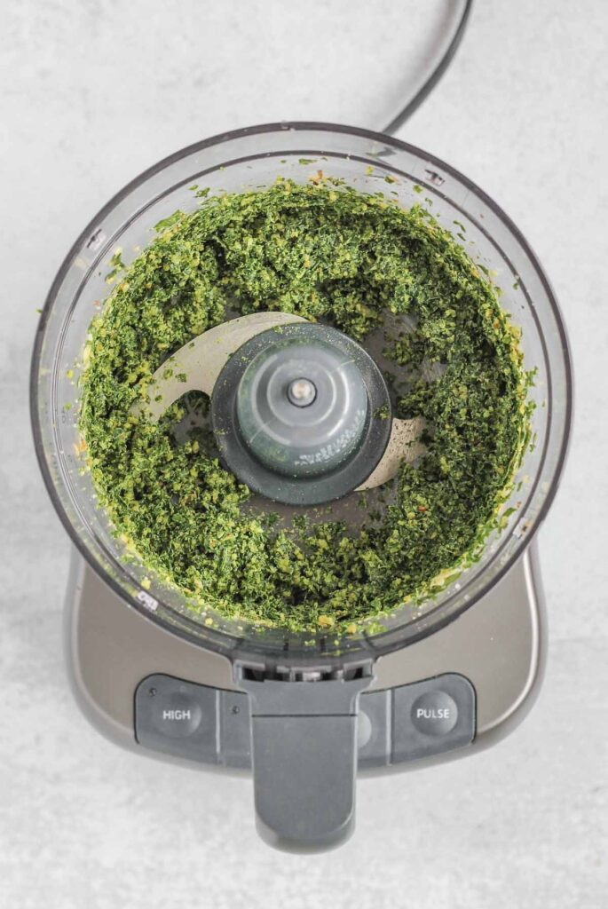 pesto ingredients blended in a food processor