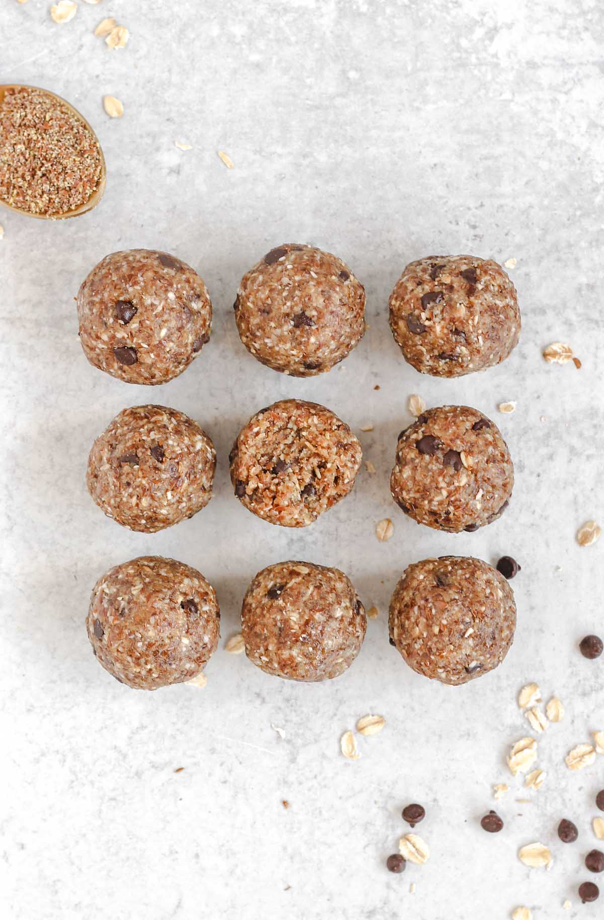9 nut-free energy balls laid out on a gray surface