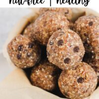 nut free energy bites in a bowl with text overlay for Pinterest
