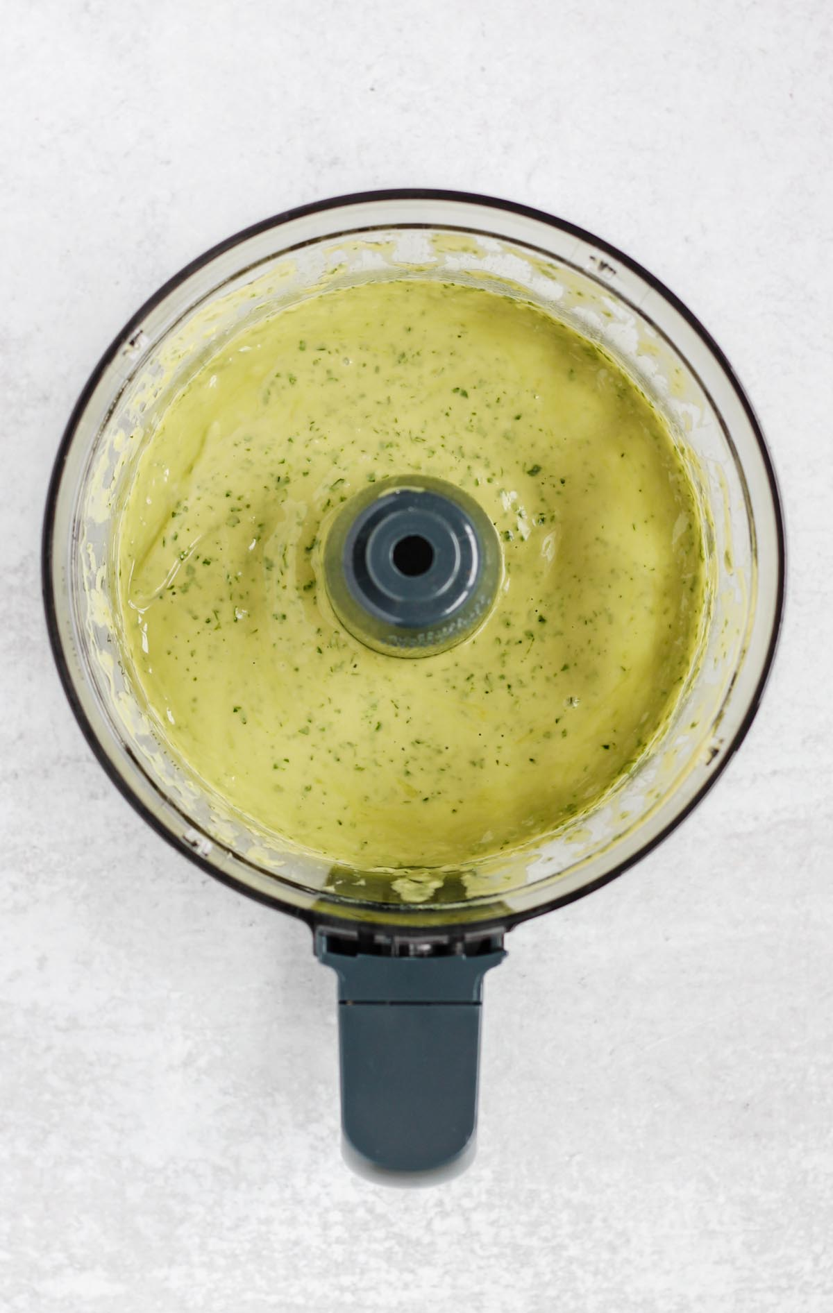 Creamy cilantro lime dressing in a food processor.