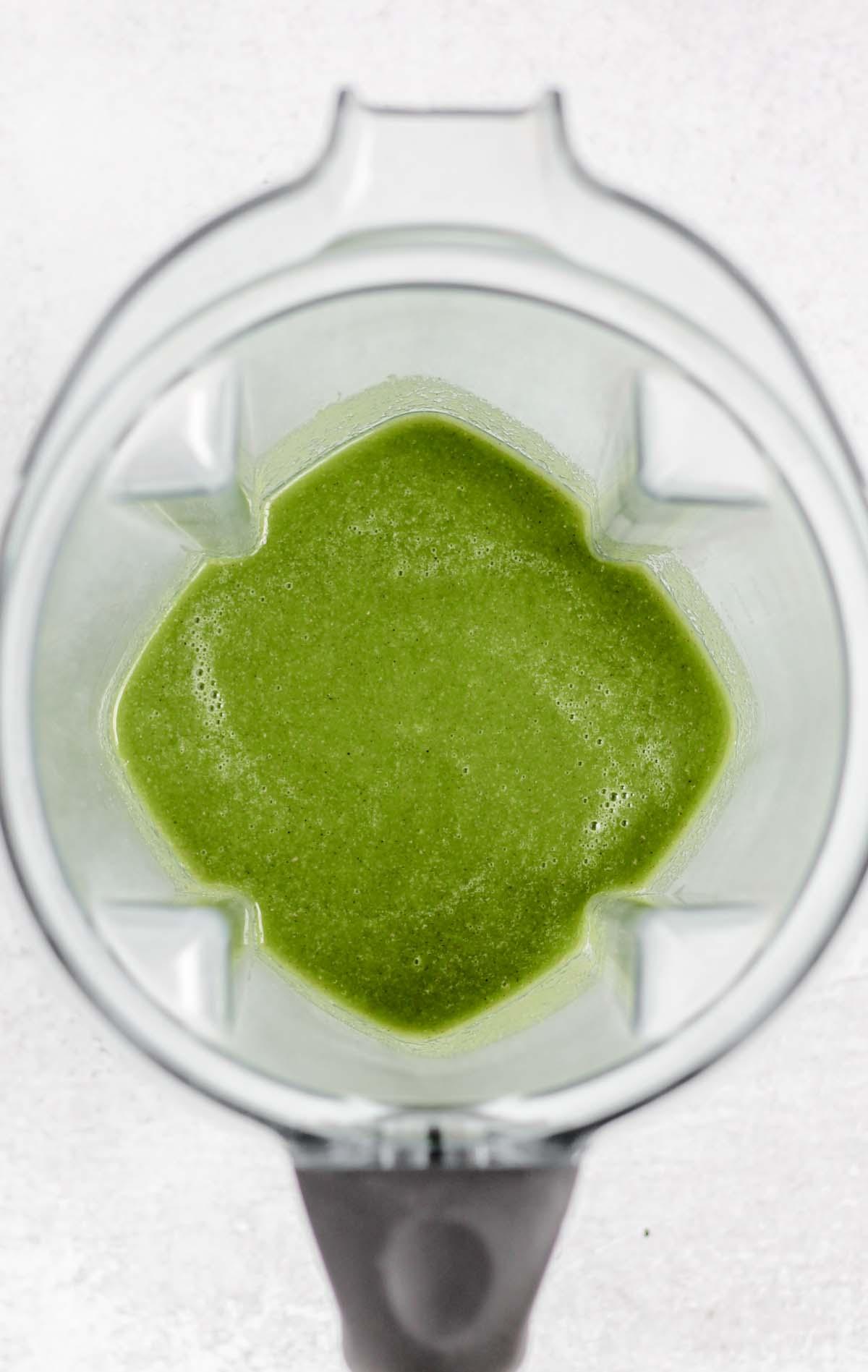 Blended green smoothie in a blender.