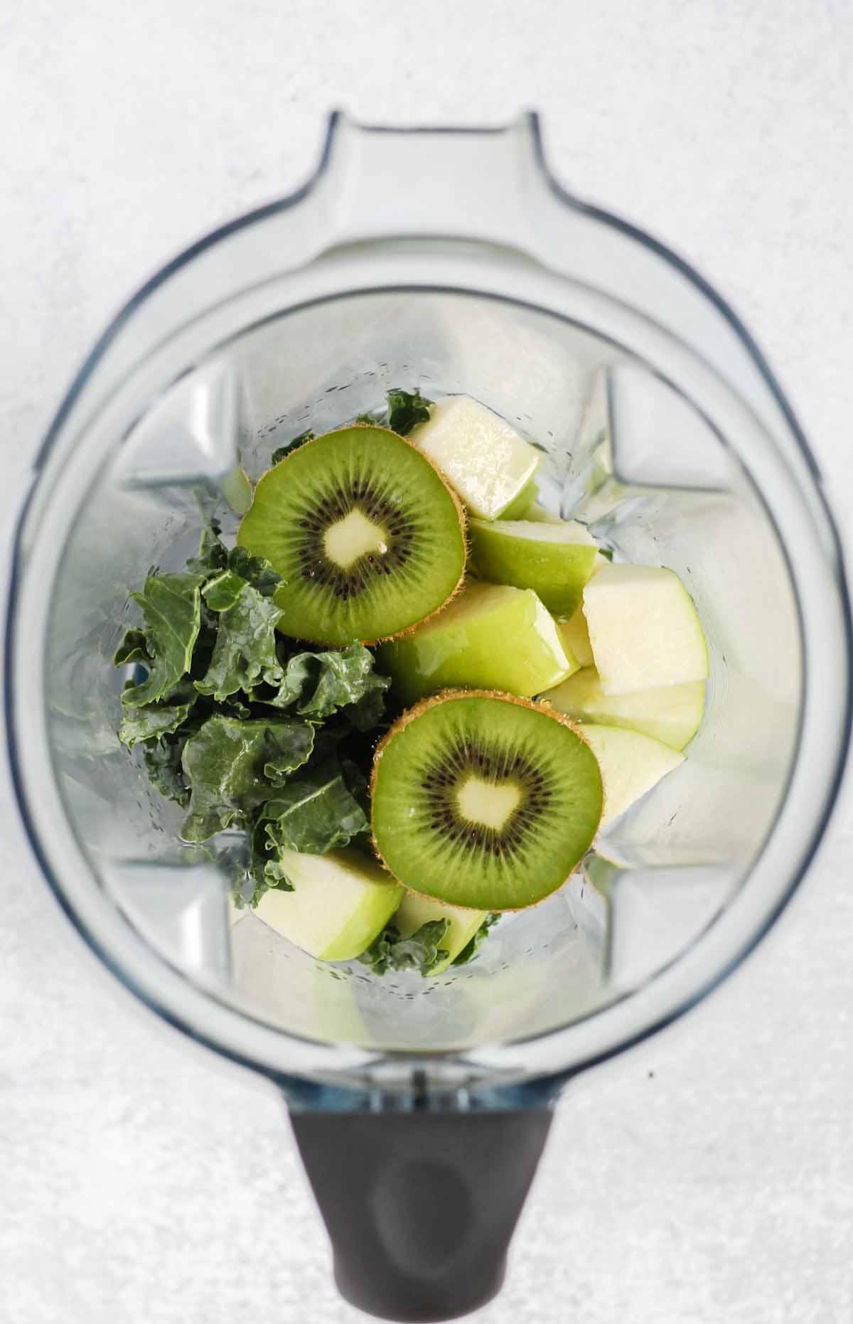Ingredients for kale smoothie in a blender.