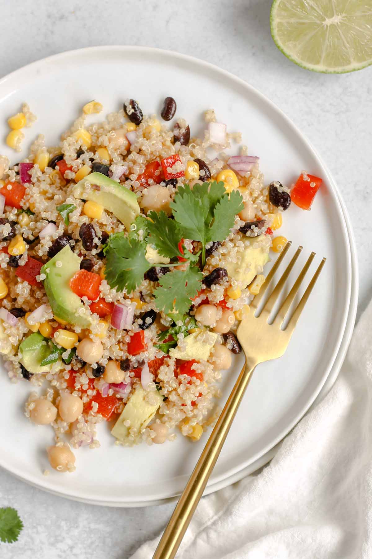 Single serving of southwest quinoa salad on a small white plate.