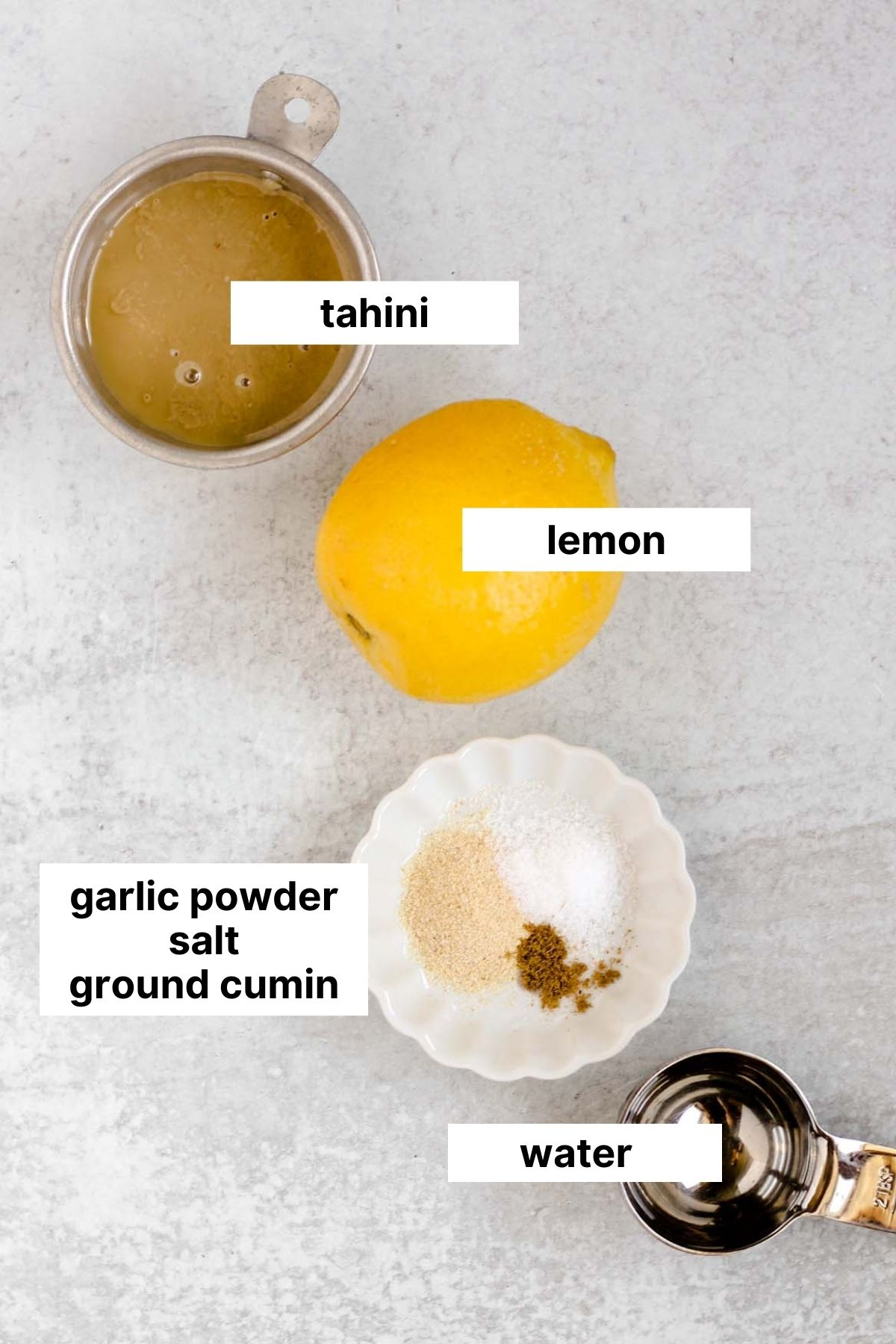 Labeled ingredients needed for tahini dressing.