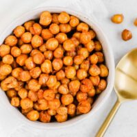 Small bowl filled with roasted chickpeas.