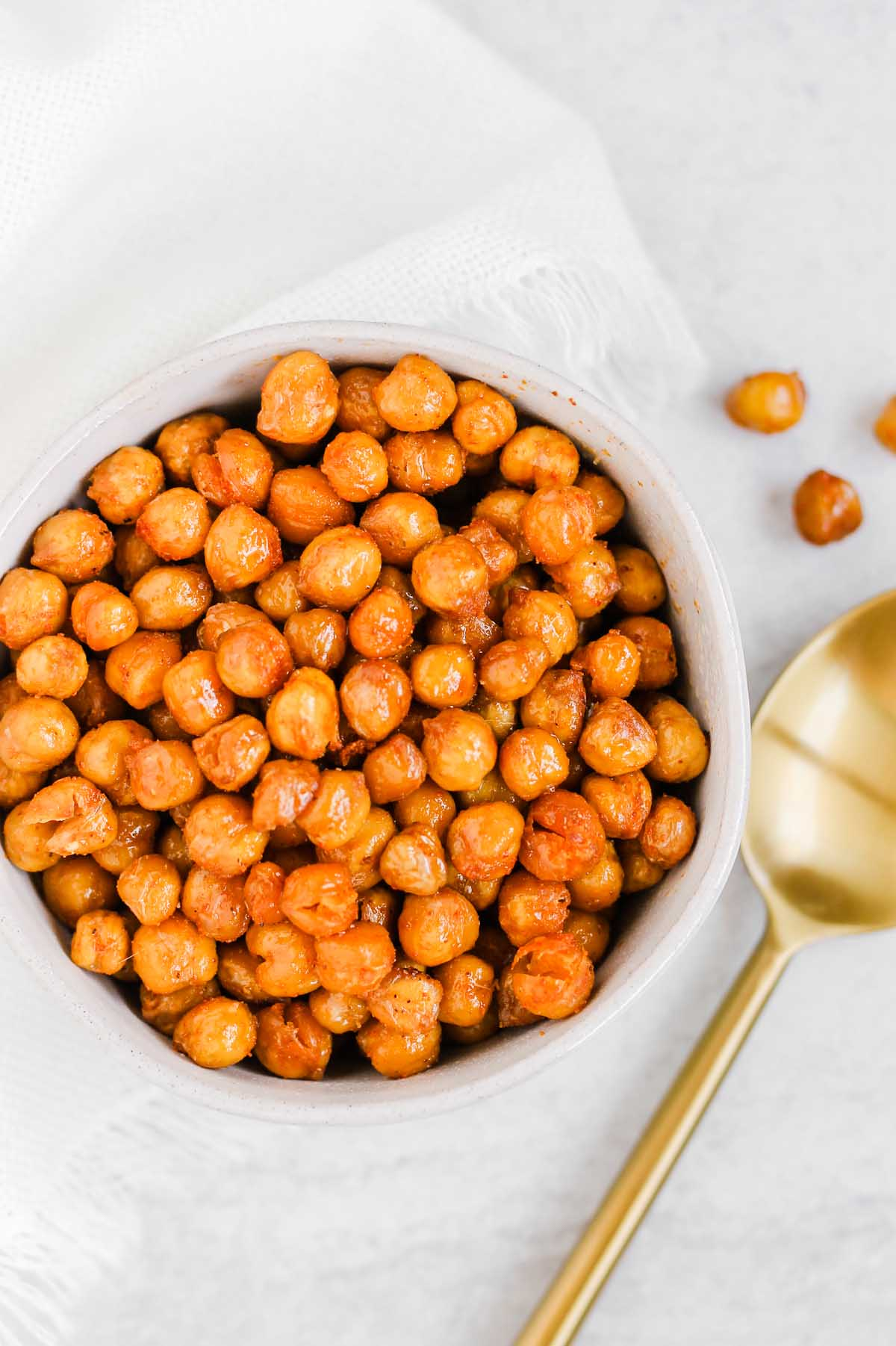 Roasted chickpeas in a white bowl.