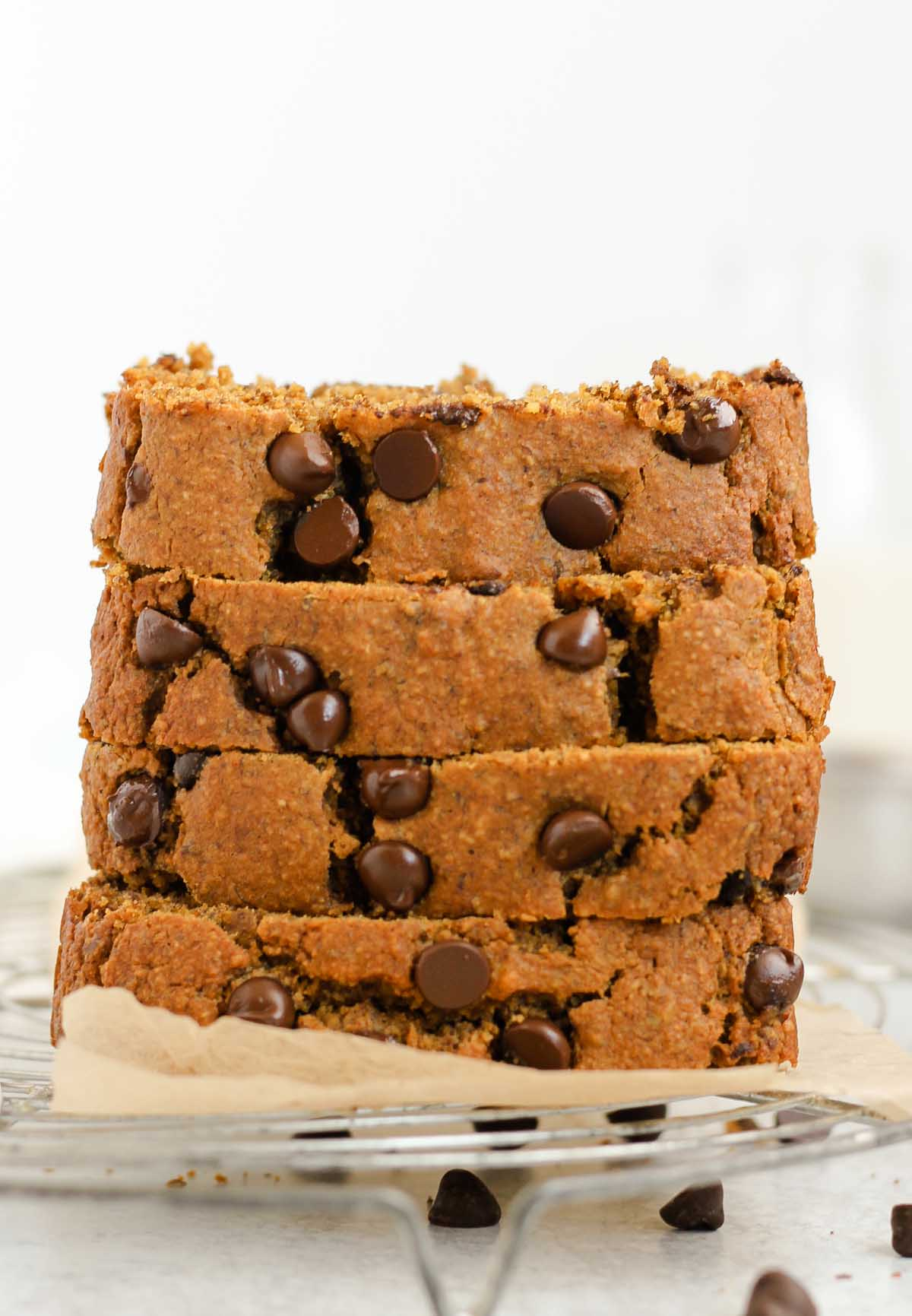 Four pieces of pumpkin chocolate chip bread stacked.