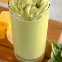Pinterest pin for creamy mango spinach smoothie.
