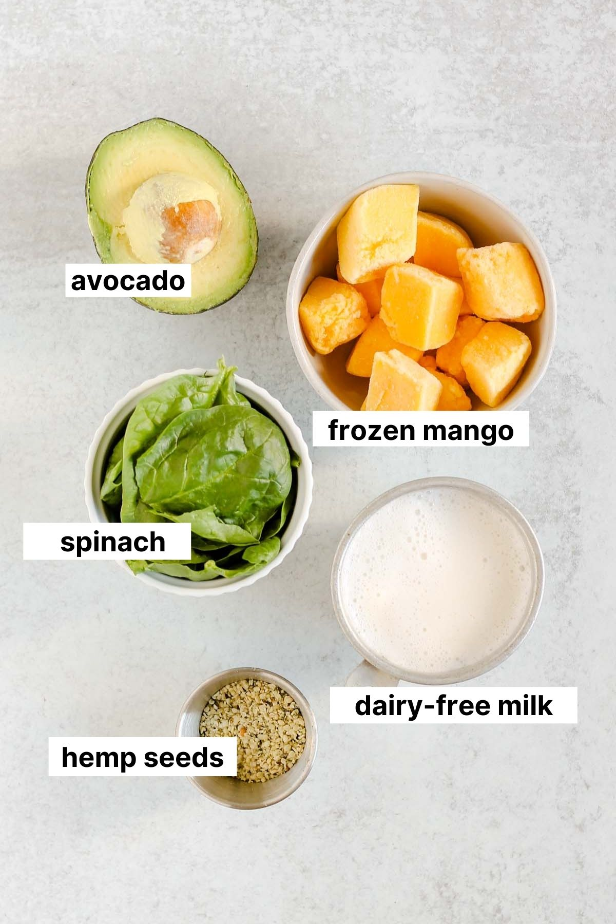 Labeled ingredients for mango spinach smoothie.